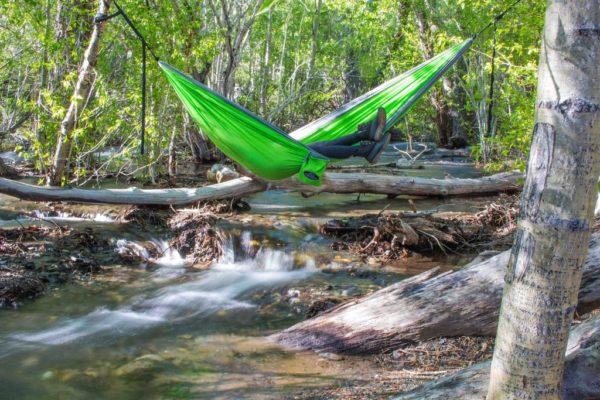 Apache Madera Hammocks hanging over river and log