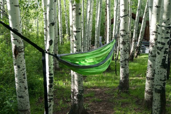 Apache Madera Hammocks Green hanging on two trees