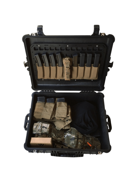magazines and ammo set up with molle panel in case