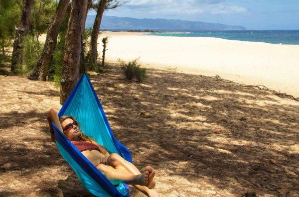 Azul Madera Hammocks Blue with women laying down at beach