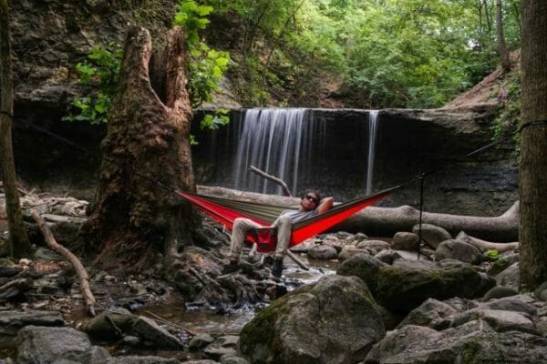 Indian Paintbrush Madera Hammocks tied to trees by waterfall