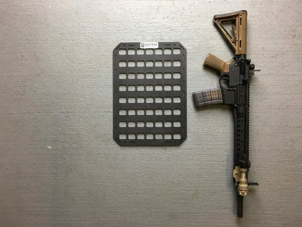12.25 X 17 RMP™ Backpack Insert molle panel with rifle next to it