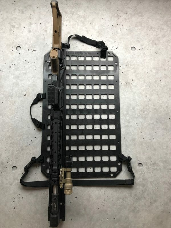 Vehicle locking rifle rack raptor rail buffer tube rack with rifle locked in place